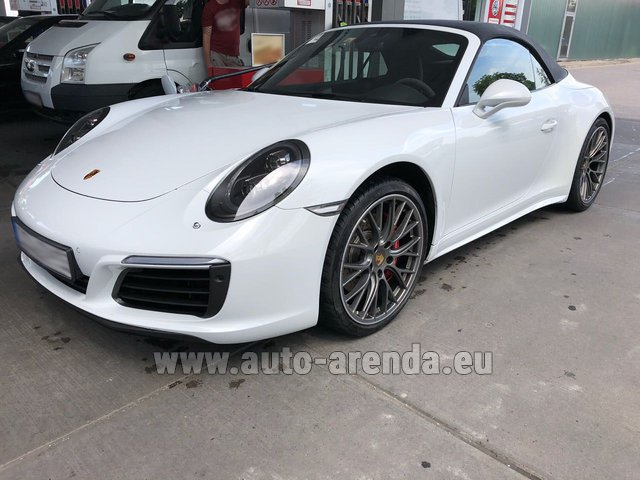 Hire and delivery to Saint-Martin-de-Belleville the car: Porsche 911 Carrera 4S Cabrio White